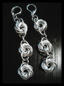 The rosettes are bright aluminum rings and the smaller rings that connect them together are stainless steel. I used silver-toned lever back earrings to finish them.