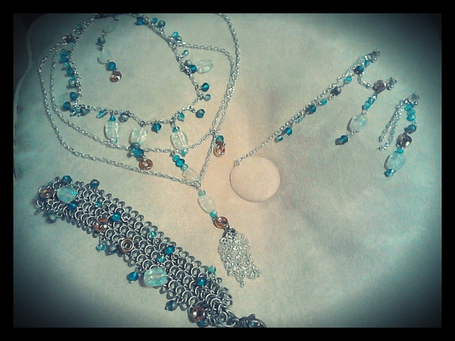 3-strand necklace, wide bracelet with bead accents, 3 piece earring set by Melody