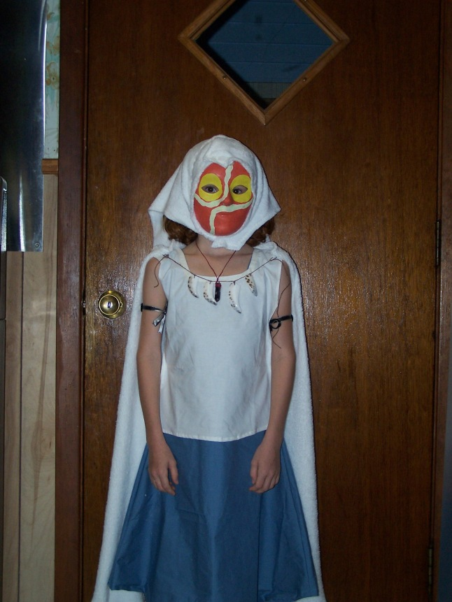 This is the San costume with the mask/hood, fur cape, crystal dagger, teeth, arm bands, shirt, and dress.