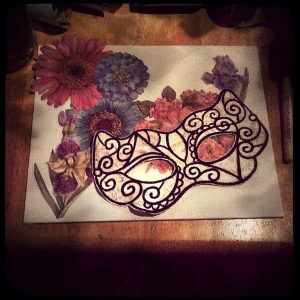 I started with a fabric mask, embroidered at the shop where I work part-time, some paperboard flowers and a blank canvas panel.