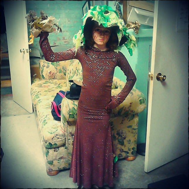 Photo taken by Melody ~ I used the camera that came with my phone to take the photo and the Pixlr-O-Matic app to edit it. This shows her hat, dress, nest and birds.