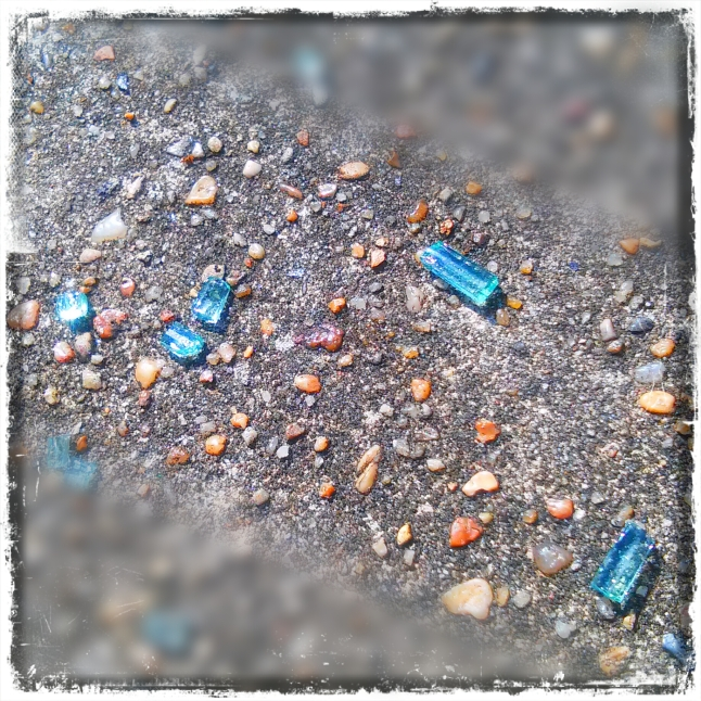 I snapped this shot of glass shards while we were walking the perimeter of St. Louis Cemetary 1. I used Pixlr Express to edit the shot. I did a lot more with this one than the rose photo.